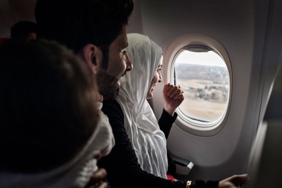 Taimaa on the plane with husband Mohannad and their children. Wael and Heln, on the first airplane flight of their lives arriving in Estonia's capital, Tallinn. Lynsey Addario—Verbatim for TIME