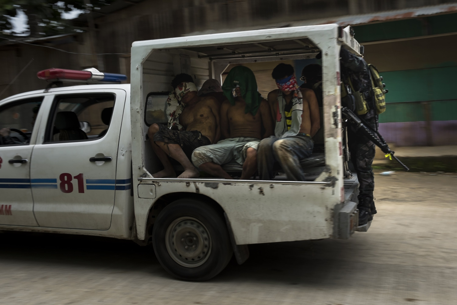 Suspected ISIS-linked militants are taken away on June 3 by authorities after they were caught trying to escape by crossing a river on June 3. Jes Aznar—Getty Images