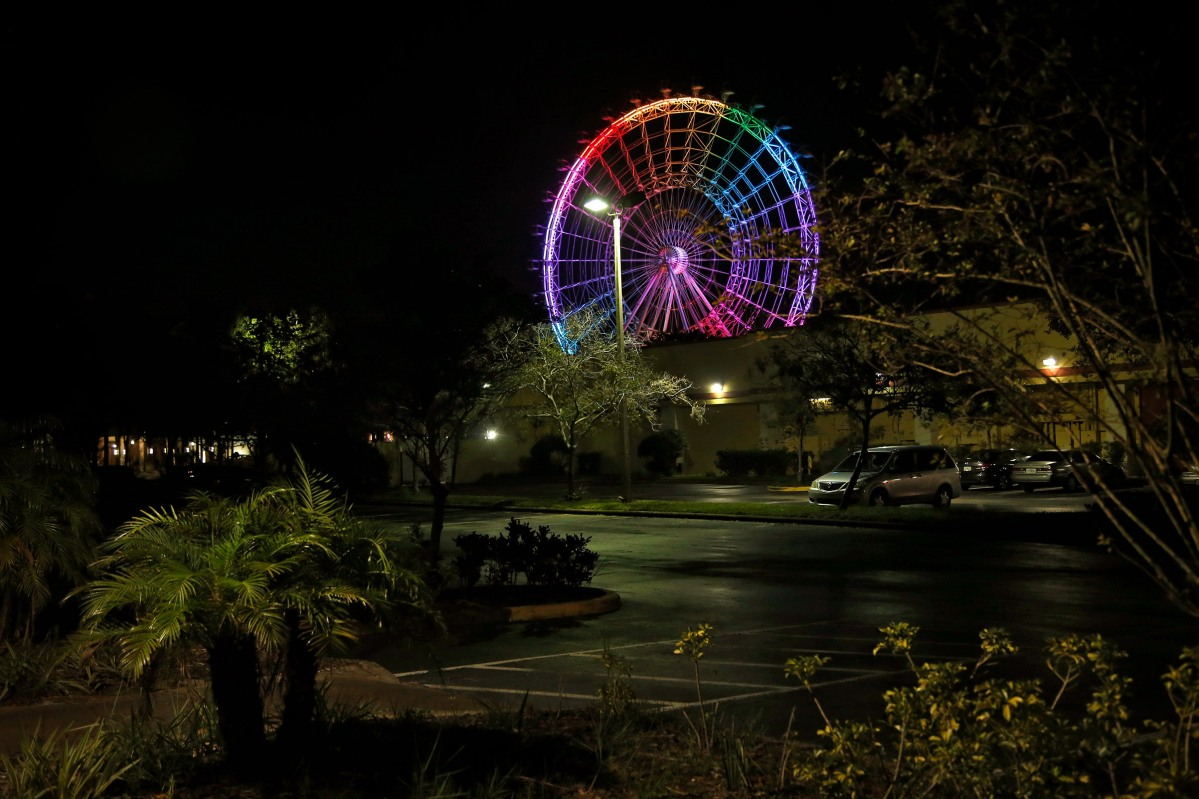 "<span class=""credit"">Preston Gannaway</span><span class=""caption"">The Orlando Eye lights up in Pride colors on the six month anniversary after the Pulse shooting in Orlando on December 12, 2016. </span>"