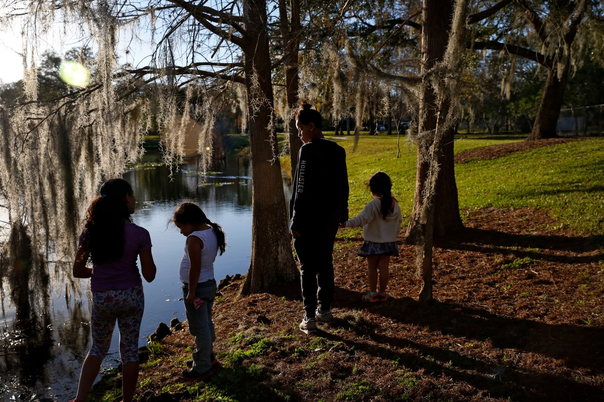 Pulse survivor Kaliesha Andino takes her little sister and neighborhood kids to a park in Orlando, Fla., on Friday, February 10, 2017.