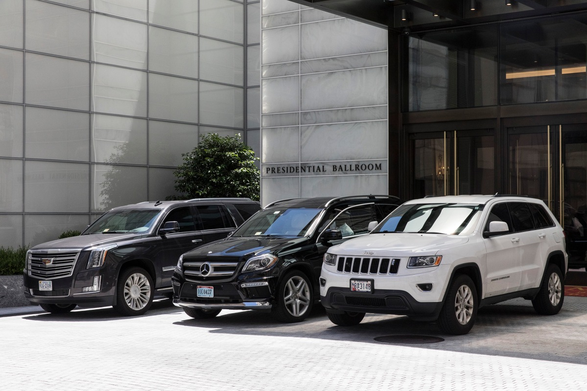 "<span class=""credit"">Christopher Morris—VII for TIME</span><span class=""caption"">Luxury SUV's line up outside of the presidential ballroom at the Trump International Hotel.</span>"