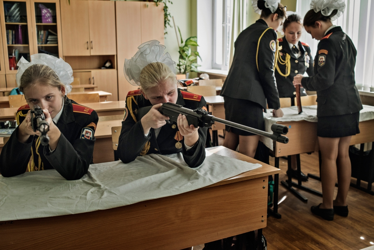 Young girls learn how to assemble and shoot rifles at a cadet boarding school in Moscow.