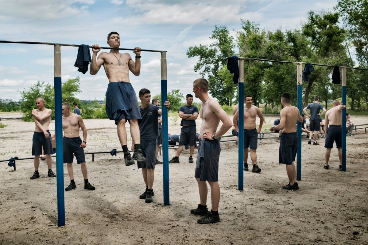 Young men do morning exercises, Voronezh, Russia, June 2016.