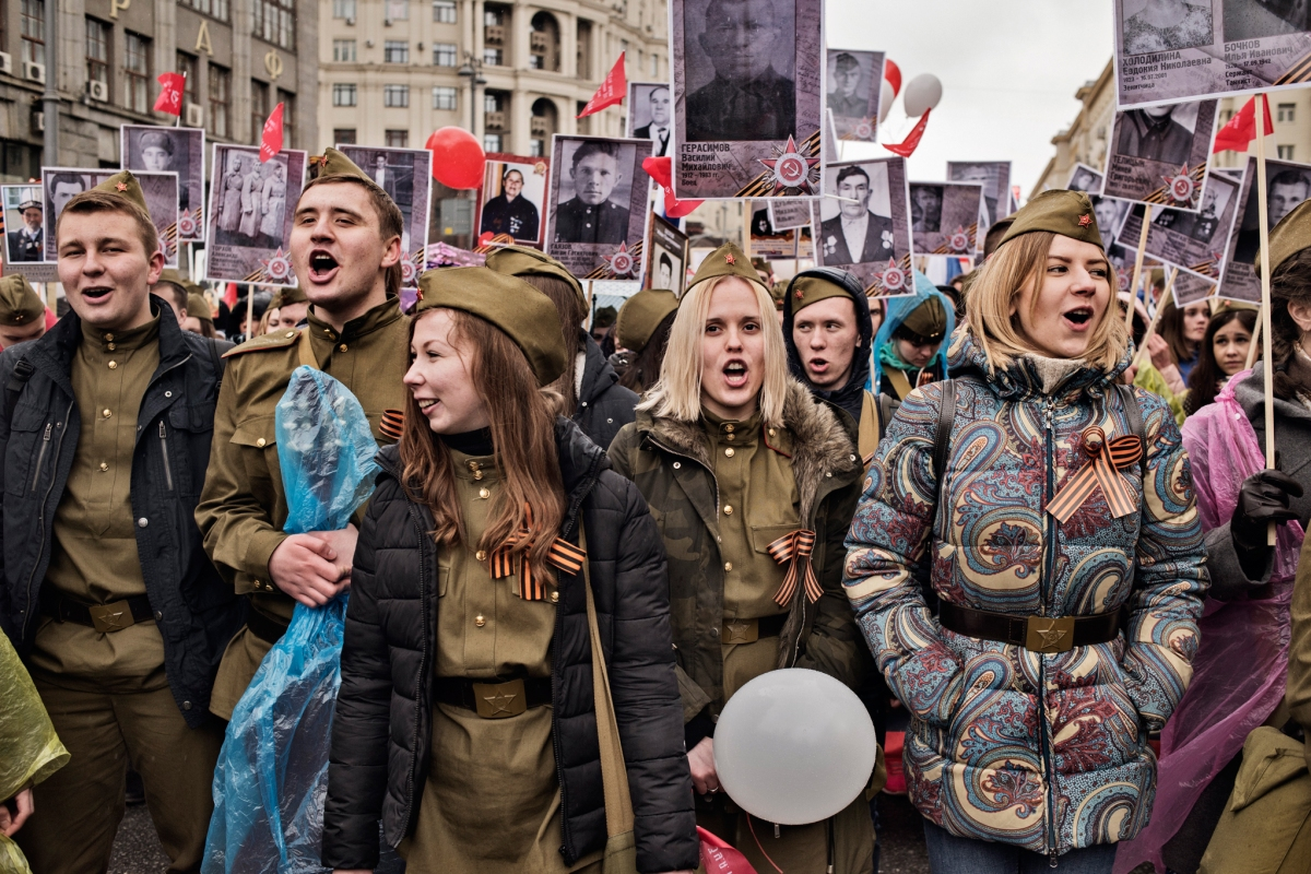 Young patriots carry portraits of World War II soldiers during the annual Victory Day march, marking the anniversary of the 1945 defeat of Nazi Germany, Moscow, May 9, 2017.