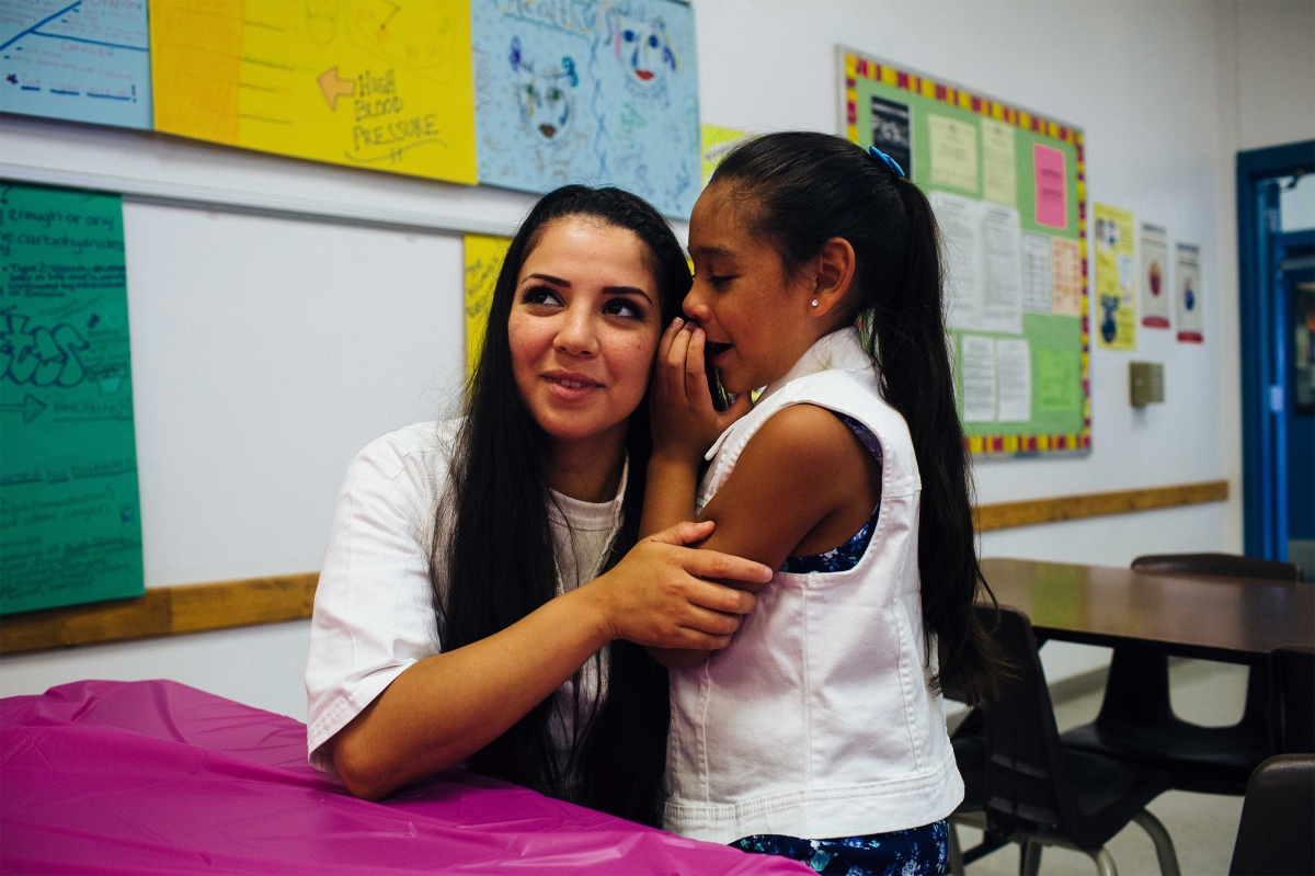 """Layla Arenas, 7, is spending her Saturday morning visiting her mother Magan Garcia. Magan says she lives for the visits with her daughter. """"She's the reason I can keep going in here,"""" Magan says. Sara Naomi Lewkowicz for TIME"""