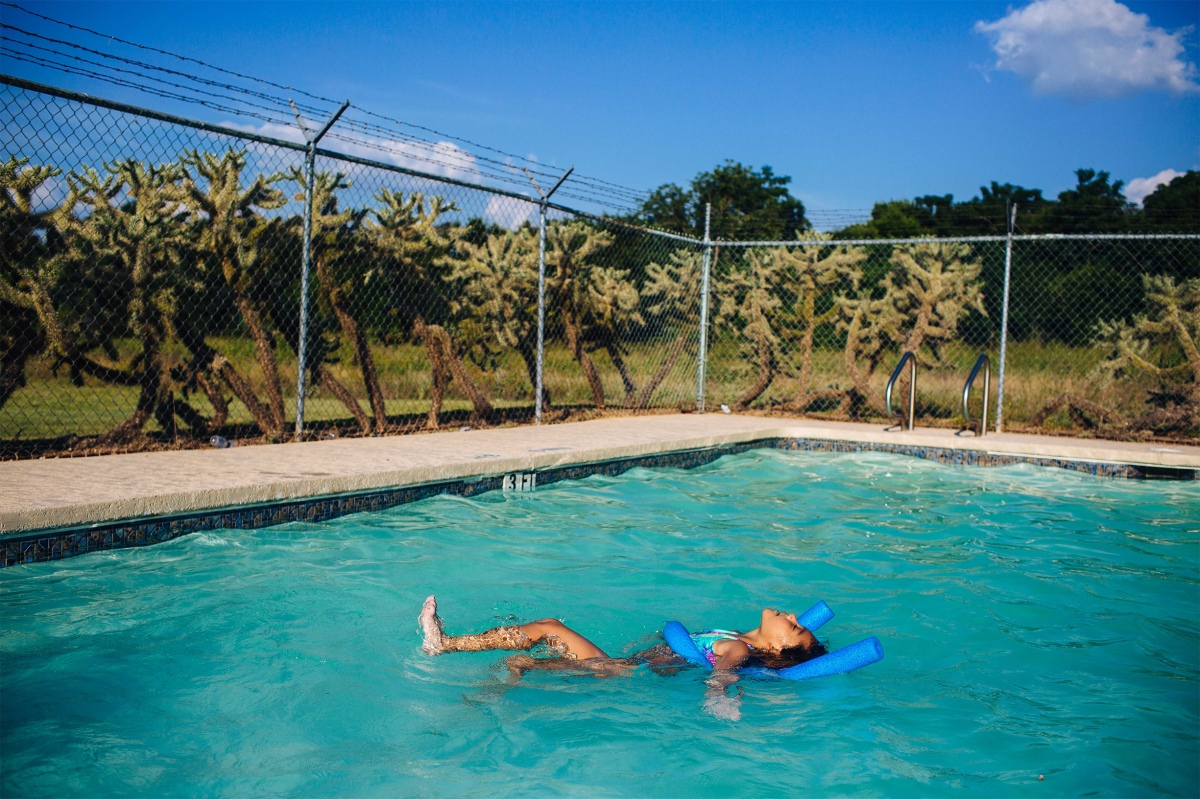 Layla plays in the community pool near her grandmother's home. Sara Naomi Lewkowicz for TIME