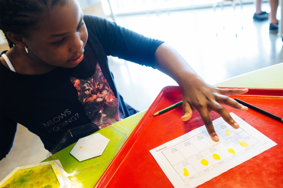 Trunarah Miller, 8, spends an afternoon at The Thinkery in Austin with her Girl Scouts mentor. Sara Naomi Lewkowicz for TIME