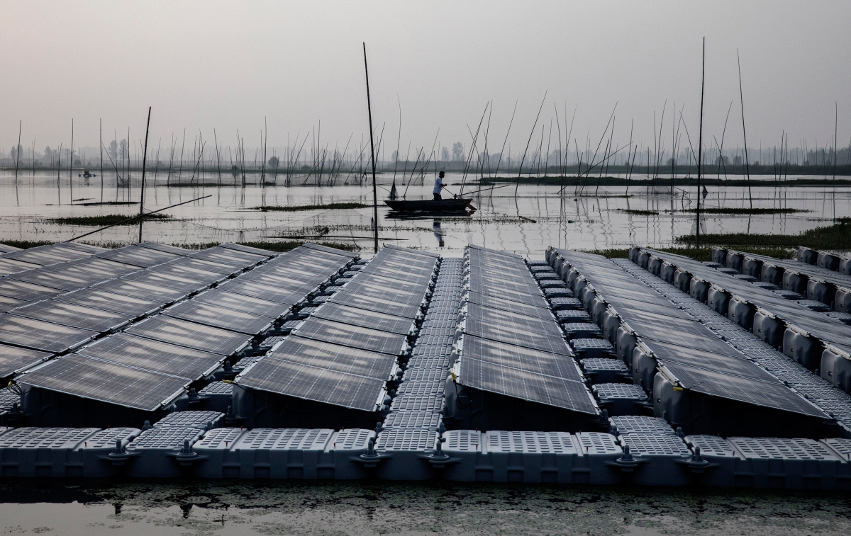 A local fisherman passes a section of floating panels.