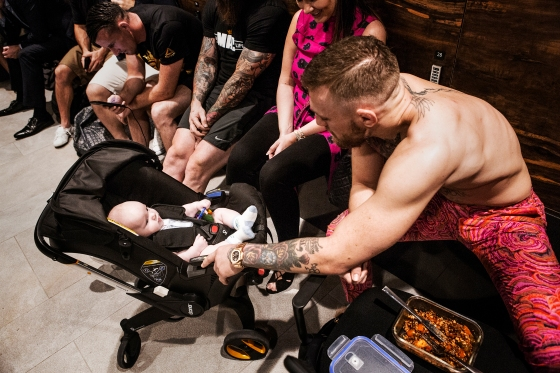 UFC lightweight champion Conor McGregor takes a break with his infant so.n