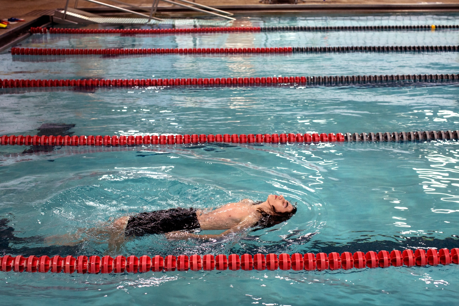 Nazeer Tameem swims at recreation facility.