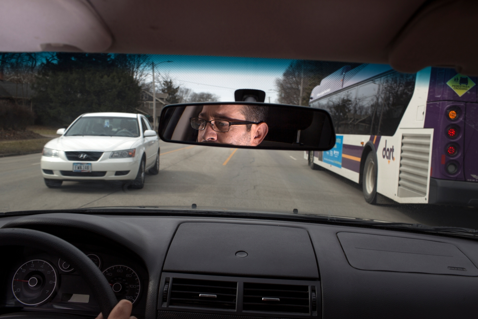 Abdul Fattah Tameem drives to the store in West Des Moines. Abdul Fattah and his wife, Ghazweh Aljabooli, moved their family to West Des Moines, a suburb of Des Moines, Iowa.