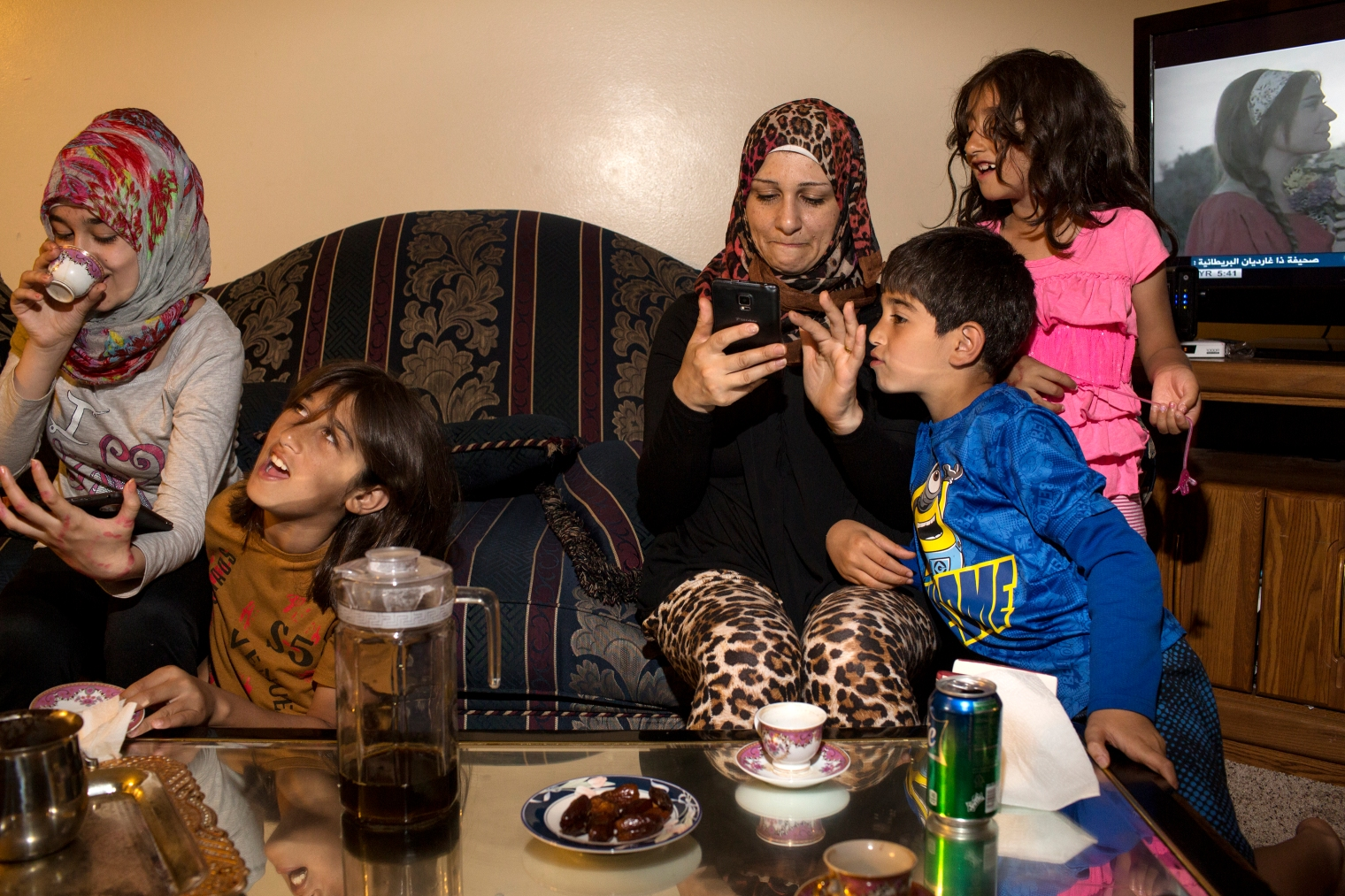 Ghazweh Aljabooli and her children, Sedra, Haidar, Mutaz and Hala (left to right) after breaking their fast during Ramadan at their apartment in West Des Moines, Iowa.