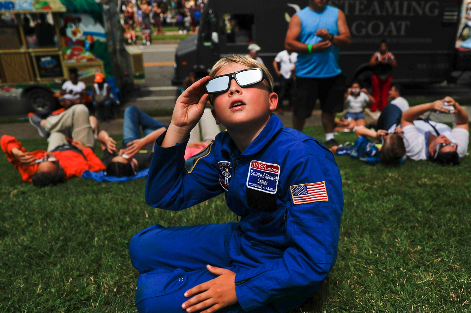 Tyler Hanson, of Fort Rucker, Ala., watches the sun moments before the total eclipse on Aug. 21, 2017, in Nashville, Tenn.