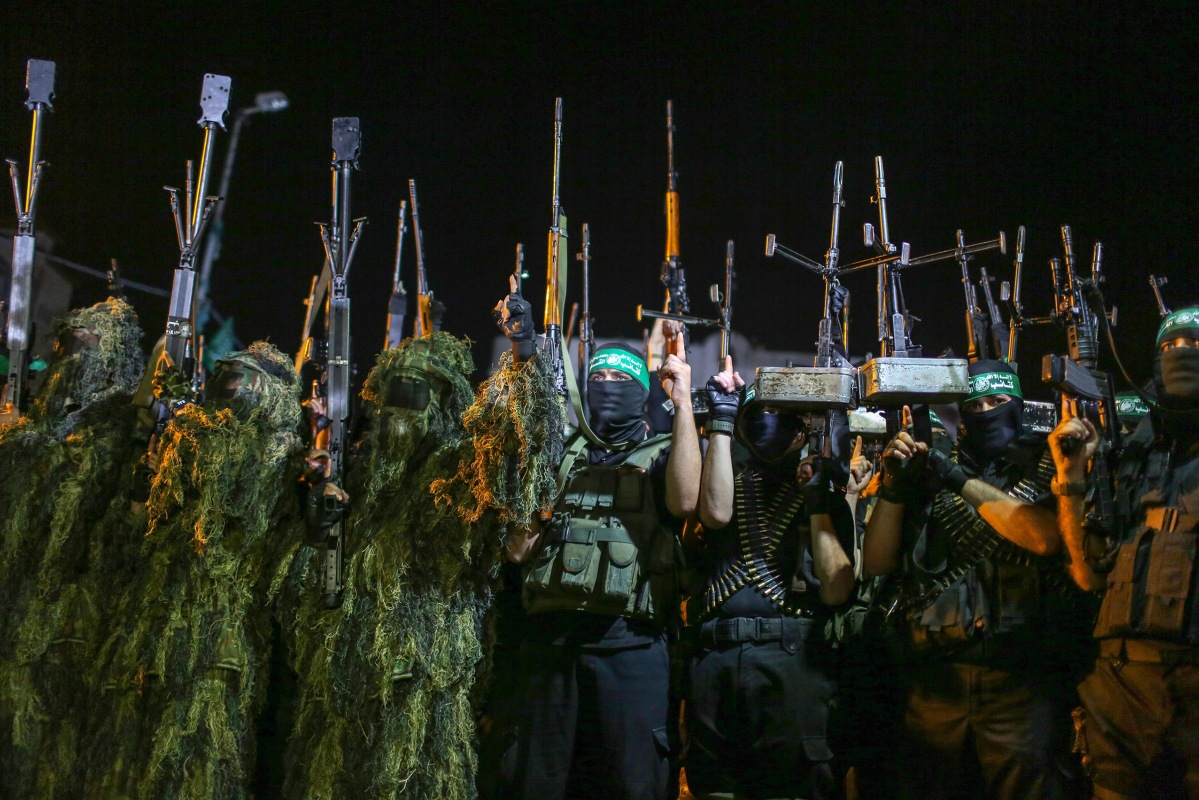 Masked Palestinian gunmen from Izzedine al-Qassam Brigades, a military wing of Hamas, march during a rally marking the first anniversary of the Israeli war on Gaza, in central Gaza City on July 8, 2015.