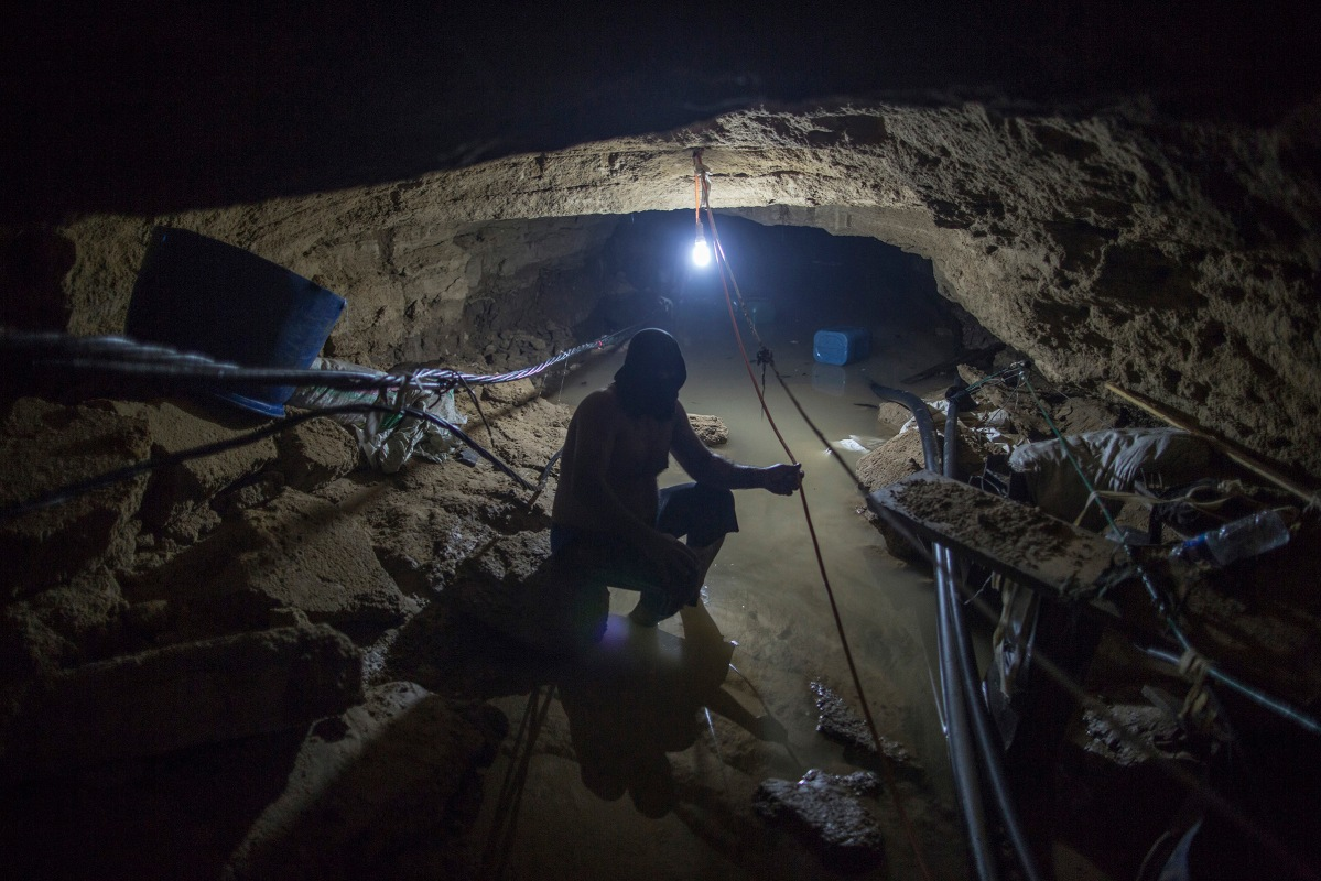 Thirty five meters under the ground, a Palestinian smuggler is trying to pull water out of a tunnel, which is linking Gaza with Egypt, after it was flooded with sea water by the Egyptian Authoriites in Rafah in southern Gaza, October 2, 2015.