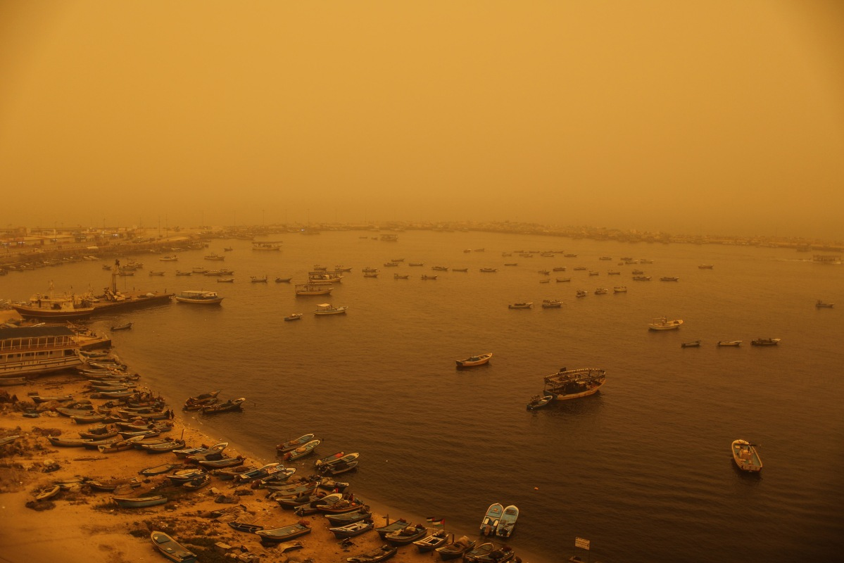 A sand storm shrouds the Gaza strip, Tuesday, Sept. 8, 2015. An unseasonal sandstorm hit many countries in the Middle East with a blanket of yellow dust on Tuesday, sending hundreds of people to hospitals with breathing difficulties and causing the deaths of two women, officials said.