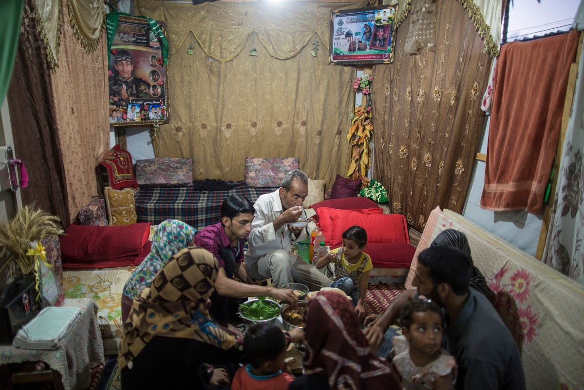 Al-Najjar family are breaking their fast at a cravan where they are staying since their house was demolished last summer on July , 6 2015.