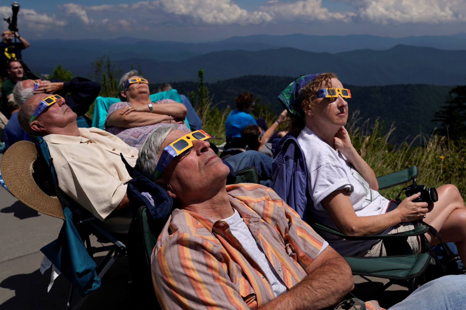 People watch as the solar eclipse approaches totality from Clingmans Dome, which at 6,643 feet (2,025m) is the highest point in the Great Smoky Mountains National Park, Tennessee on Aug. 21, 2017.