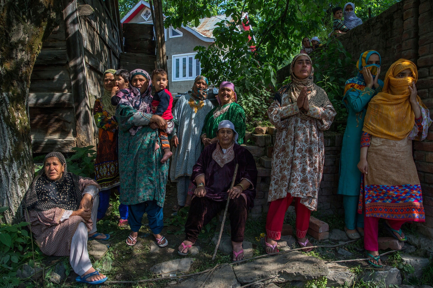 Women grieve as they watch the funeral procession of rebel leader Sabzar Ahmed Bhat in Retsuna, 45 Kilometers south of Srinagar on May 28, 2017. Thousands of people assembled in southern Tral area to take part in the funeral of the rebel leader Sabzar Ahmed Bhat, chanting slogans calling for Kashmir's freedom from Indian rule.