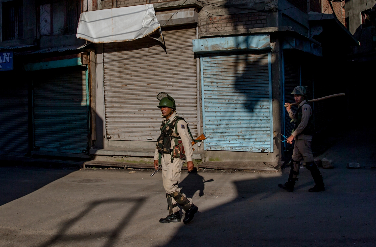 "Indian paramilitary soldiers patrol during curfew in downtown area of Srinagar on June 23, 2017. Authorities imposed stringent curfew in old parts of Srinagar and did not allow Friday prayers at the Jamia Masjid to stop anti India protests. The last Friday of the fasting month of Ramadan is observed as ""Al-Quds Day"" and ""Kashmir Day"" in the region in solidarity with Palestinians and Kashmiris."