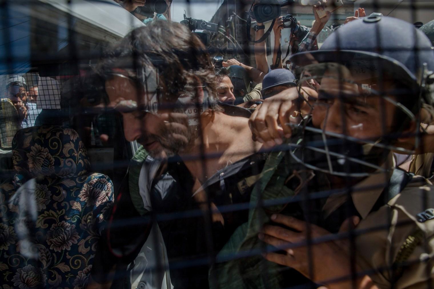 Indian policemen detain Jammu Kashmir Liberation Front (JKLF) Chairman Yasin Malik during a protest in Srinagar on June 9, 2017.
