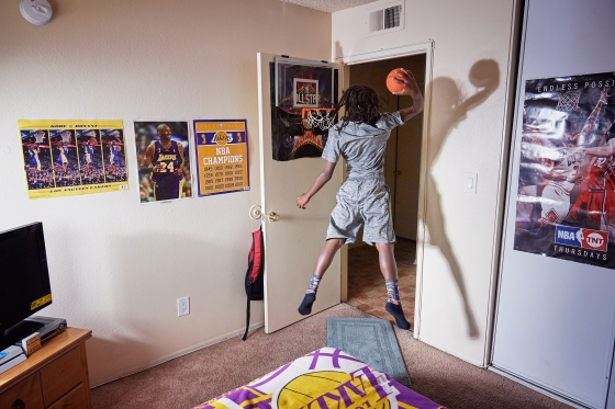 King-Riley Owens, 9, who is ranked as a five-star prospect by the National Youth Basketball Report, lives in L.A. but has already played in tournaments in Utah, Texas and Nevada. His parents have used GoFundMe to help pay for the travel. If the NBA doesn't work out, King-Riley wants to be a veterinarian. Here King-Rily is photographed at home on Aug. 2, 2017