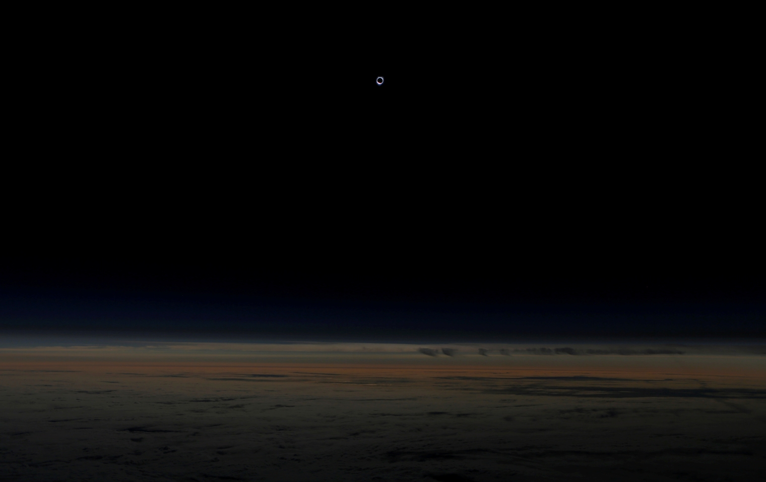 The sun is obscured by the moon during a solar eclipse, as seen from an Alaska Airlines commercial jet at 40,000 feet above the Pacific Ocean, off the coast of Depoe Bay, Ore., on Aug. 21, 2017.