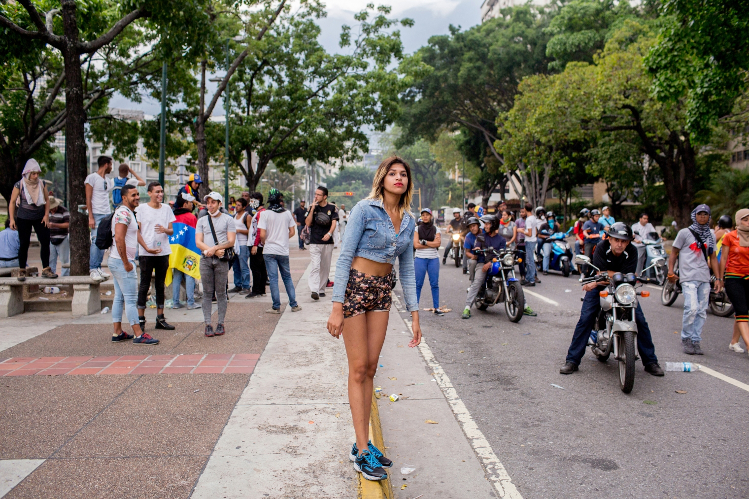 A woman stands on the median during a protest in Altamira, eastern Caracas, on April 19 2017.