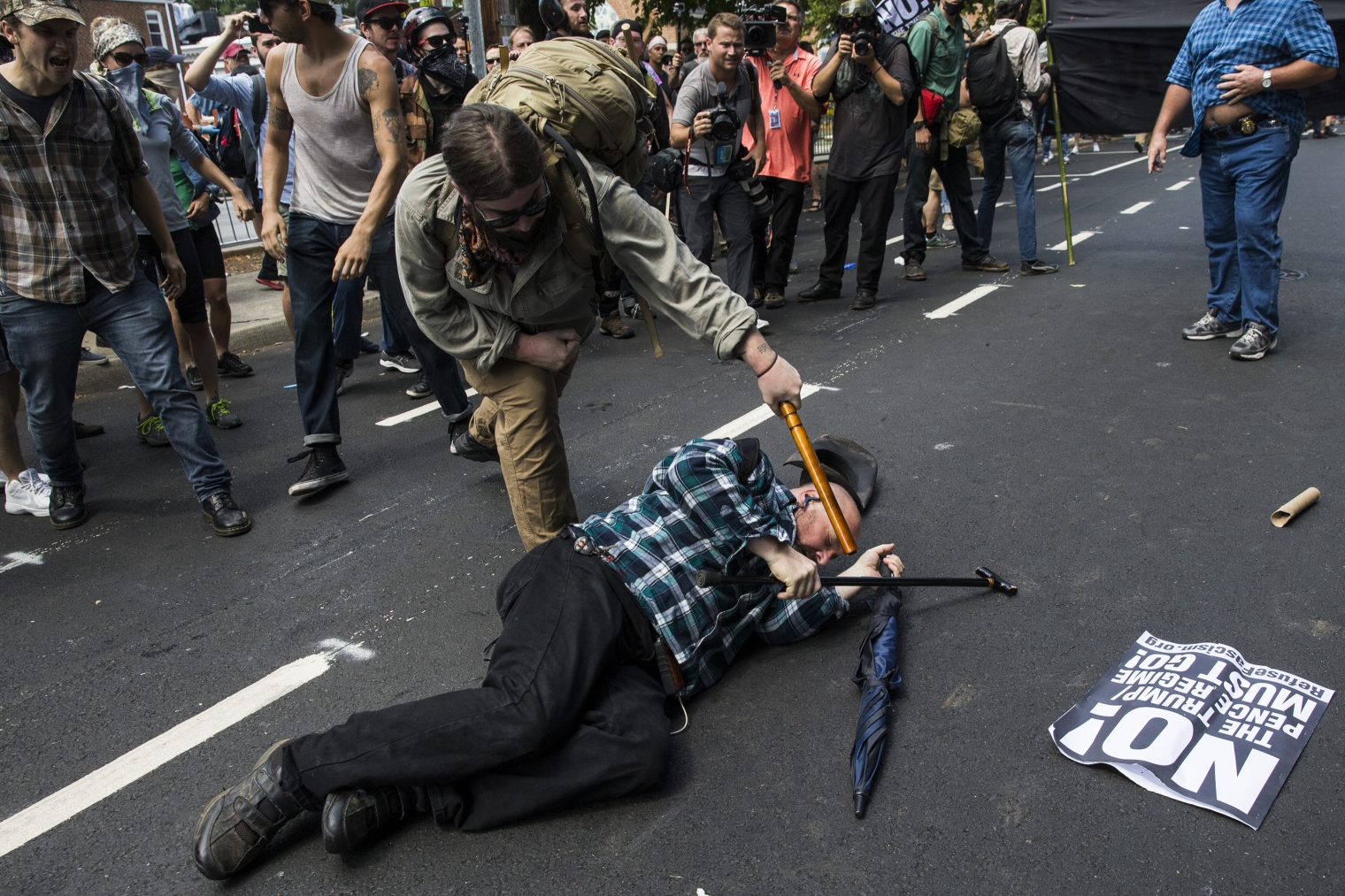 A counter-protester strikes a white nationalist with a baton during clashes surrounding a rally protesting the removal of the Robert E. Lee monument in Charlottesville, Va., on Aug. 12, 2017.