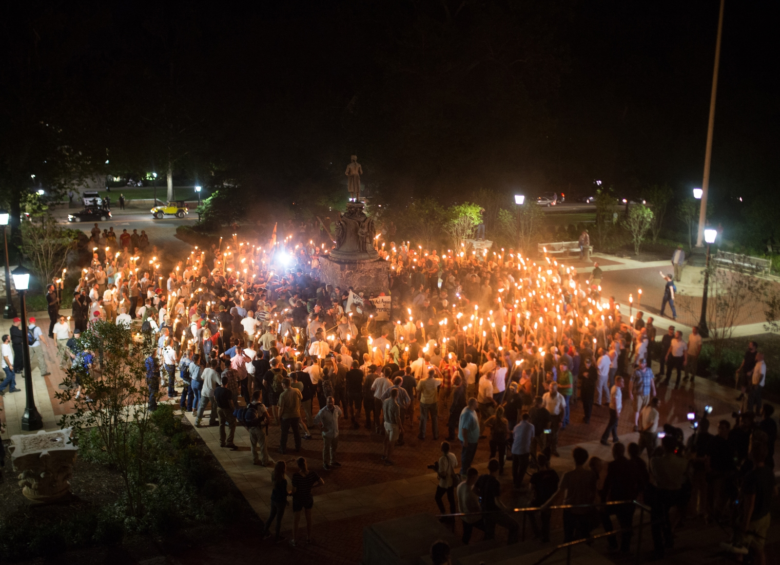 White nationalists encircle counter-protestors at the base of a statue of Thomas Jefferson after marching through the University of Virginia campus with torches in Charlottesville, Va., on Aug. 11, 2017.