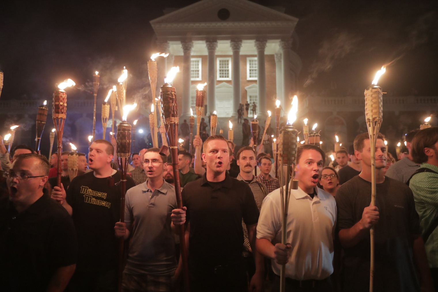 hite nationalists lead a torch march through the grounds of the University of Virginia campus in Charlottesville, Va., on Aug. 11, 2017.