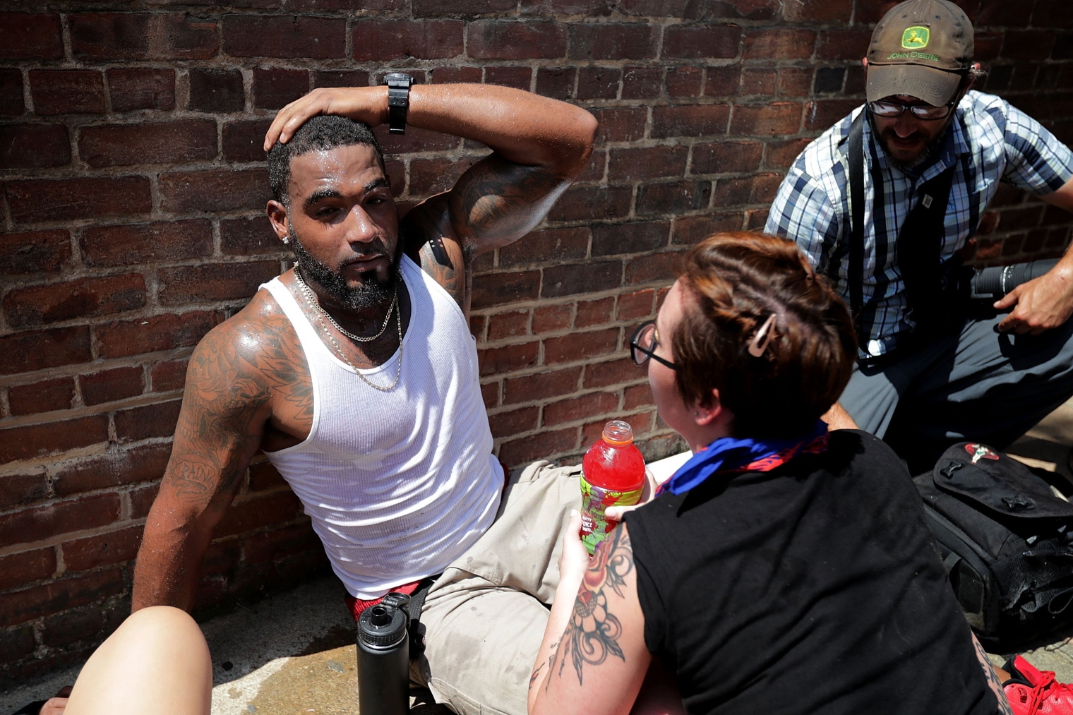 Rescue workers and volunteer medics tend to people who were injured when a car plowed through a crowd of counter-demonstrators marching through the downtown shopping district in Charlottesville, Va., on Aug. 12, 2017.