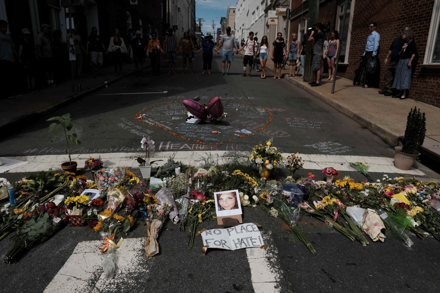 Flowers and a photo of car-ramming victim Heather Heyer lie at a makeshift memorial in Charlottesville, Va., on Aug. 13, 2017.