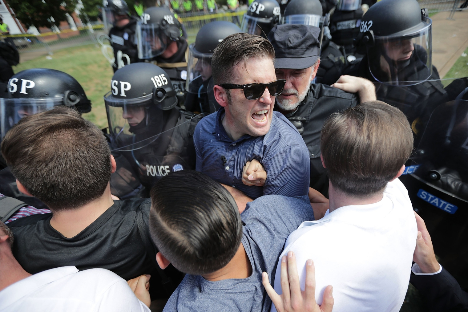 White nationalist Richard Spencer and his supporters clash with Virginia State Police in Lee Park after the