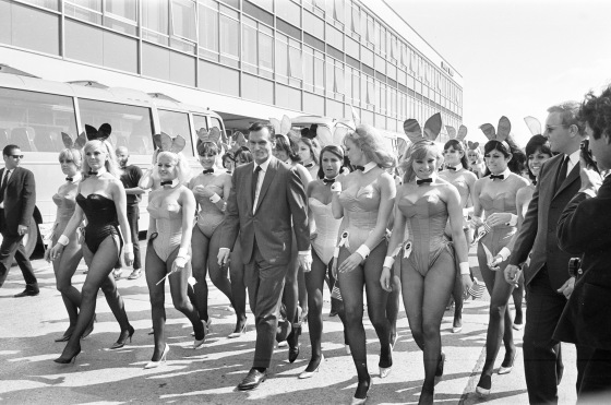 Hugh Hefner Boss of the Playboy Empire arrives with an entourage of Bunny Girls at London Heathrow Airport, Saturday 25t