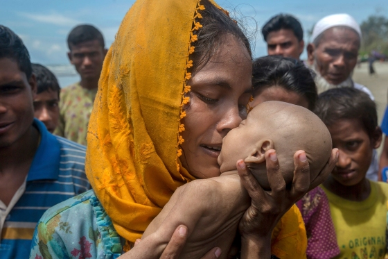 A Rohingya woman grieves for her infant son, who died when their boat capsized off Bangladesh on Sept. 14