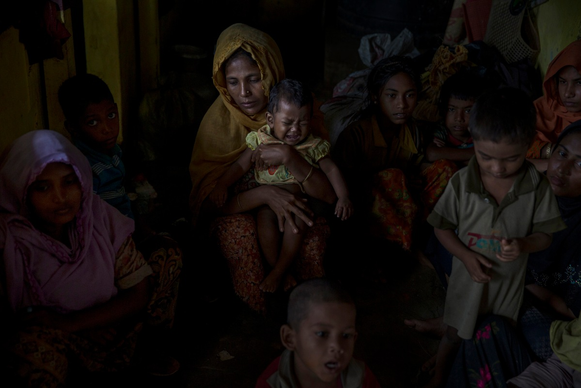 New Rohingya refugees rest in a school in the refugee camp of Kutupalong refugee camp in Ukhia,Bangladesh, September 2, 2017. he latest round of fighting broke out 10 days ago in Myanmar's neighbouring Rakhine state.The Rohingya are a mainly Muslim stateless ethnic minority who according to rights groups have faced decades of persecution in mainly Buddhist Myanmar. Bangladesh was already home to around 400,000 Rohingya before the current crisis. Figures on Sept 5th, 2017.