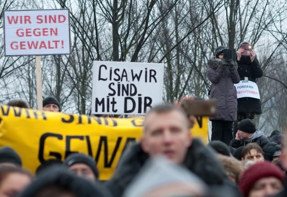 """Protesters hold up a sign reading """"Lisa, we are with you"""" as they demonstrate in front of the chancellery after Russian media spread a story -- quickly debunked by German police -- of three Muslim men who raped a 13-year-old Russian-German girl, in Berlin on Jan. 23, 2016."""