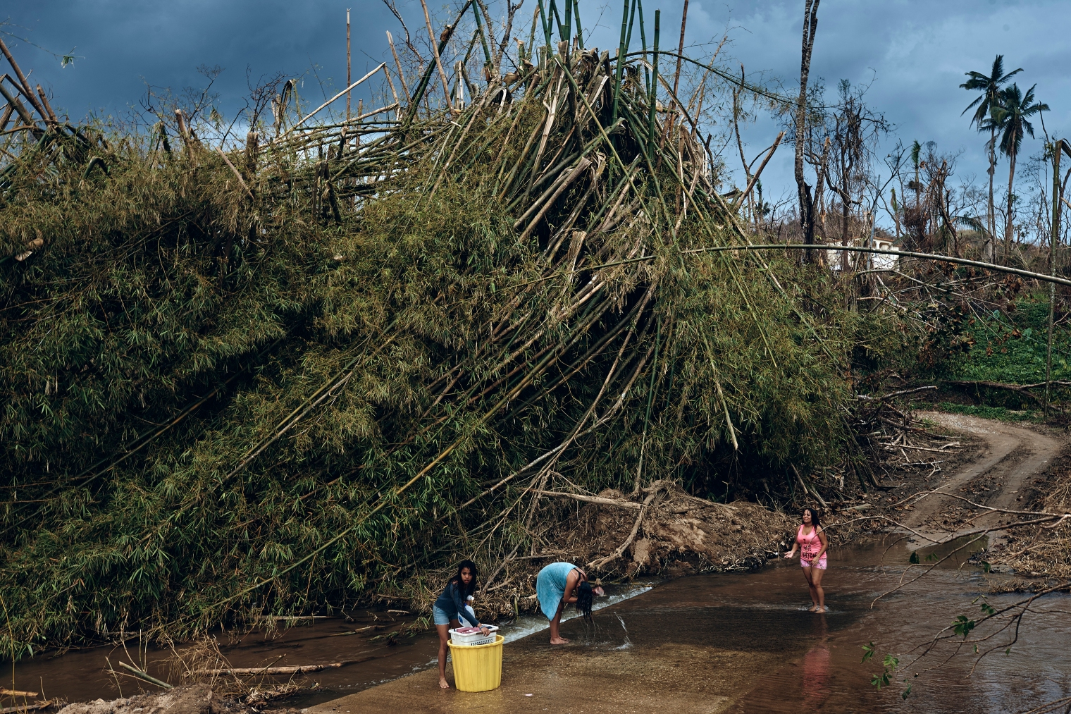 A family bathes in a river in Morovis, Puerto Rico, on Oct. 1, 2017.