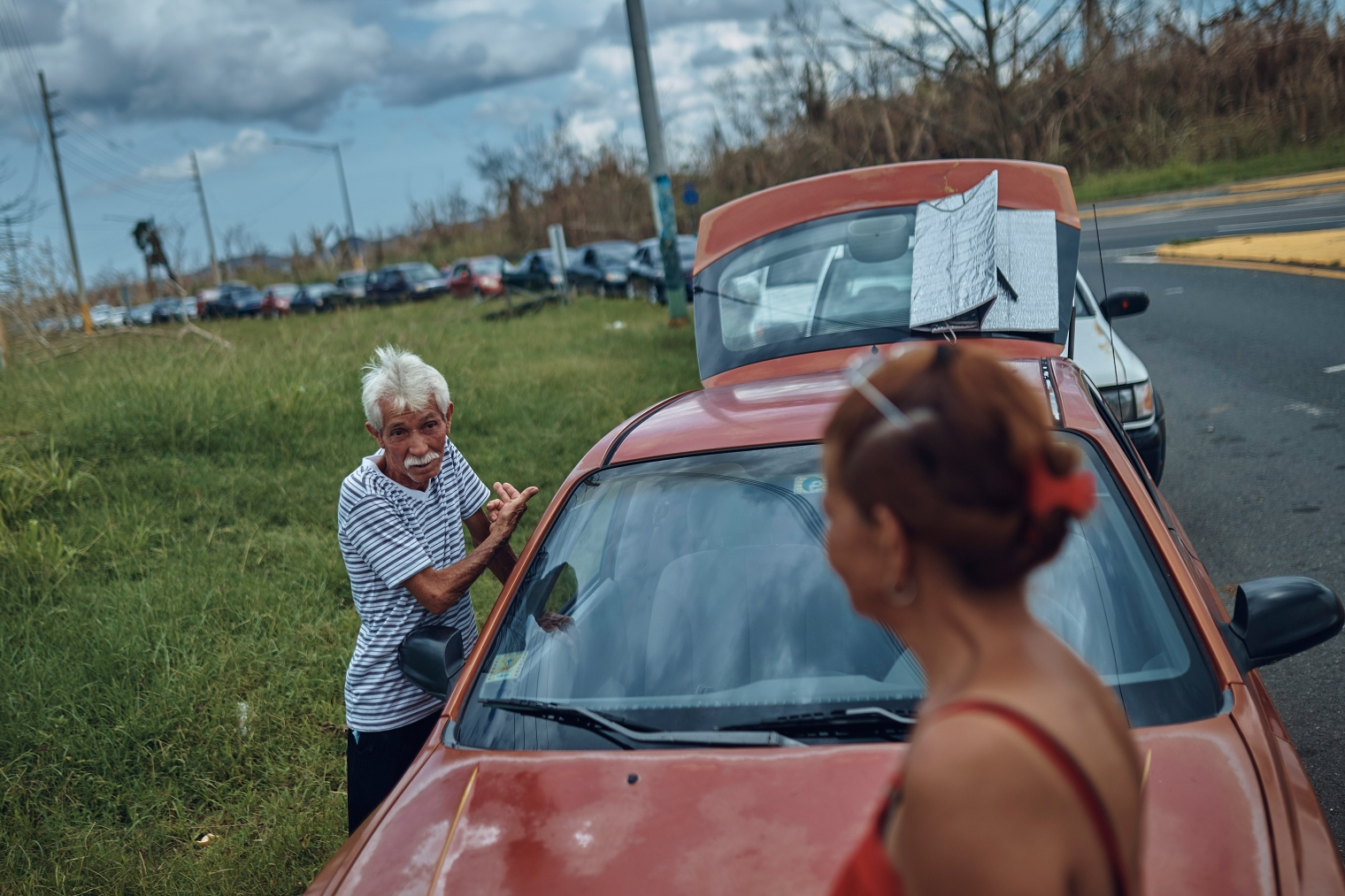 People wait in line to buy gasoline in Morovis, Puerto Rico, on Oct. 1, 2017.