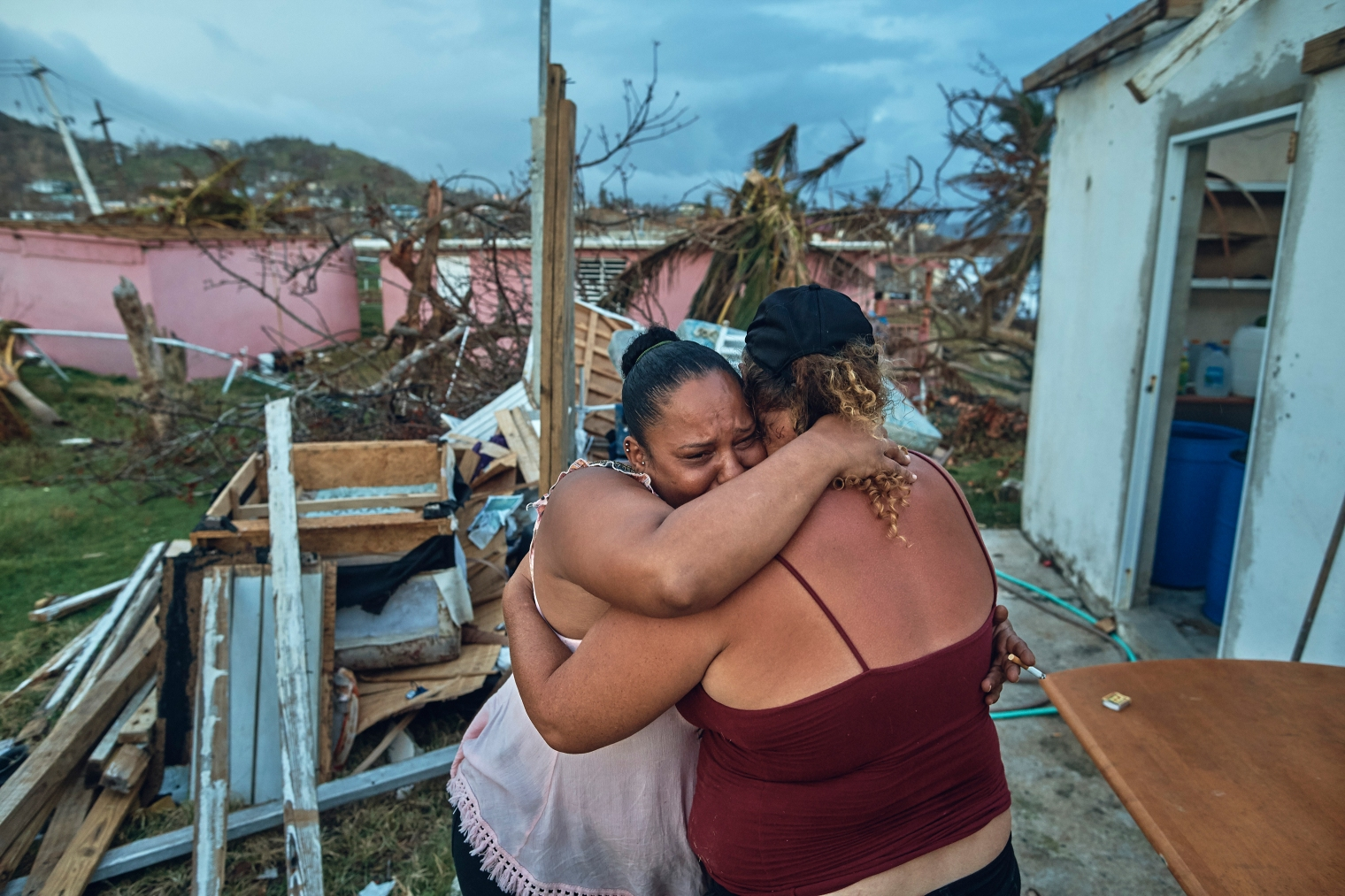 Sheila Sustache, 37, cries and hugs her aunt Yasmin Morales Torres, 41, after seeing the damage to their houses in Yabucoa, Puerto Rico, on Sept. 29, 2017.