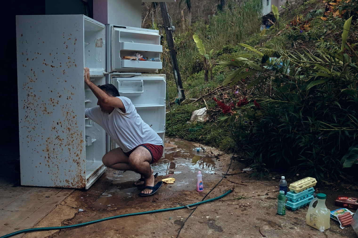 Gerardo Majero cleans his fridge in Morovis, Puerto Rico, on Oct. 1, 2017.