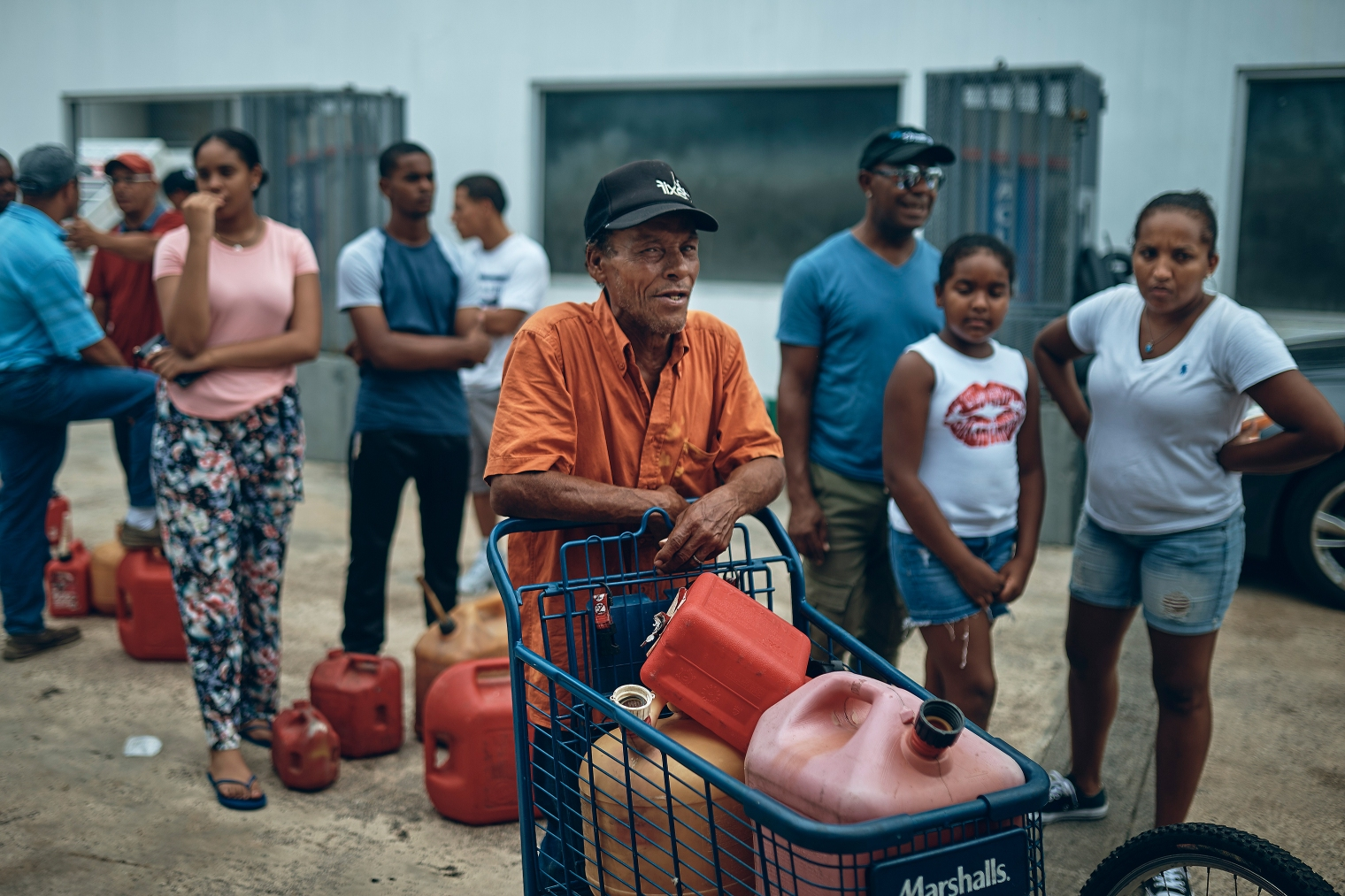 People wait in line to get fuel from a gas station in San Juan, Puerto Rico, on Sept. 30, 2017.