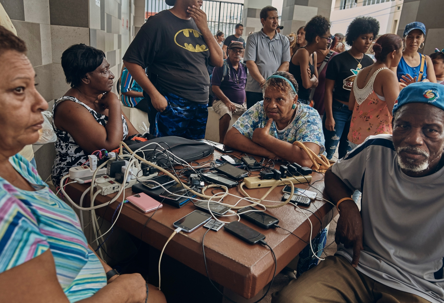 People charge their phones in San Juan, Puerto Rico, on Sept. 30, 2017.