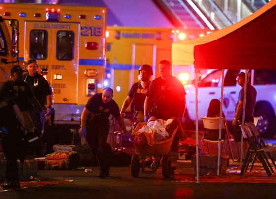 A wounded person is transported in a wheelbarrow after a mass shooting at a music festival in Las Vegas on Oct. 1, 2017.