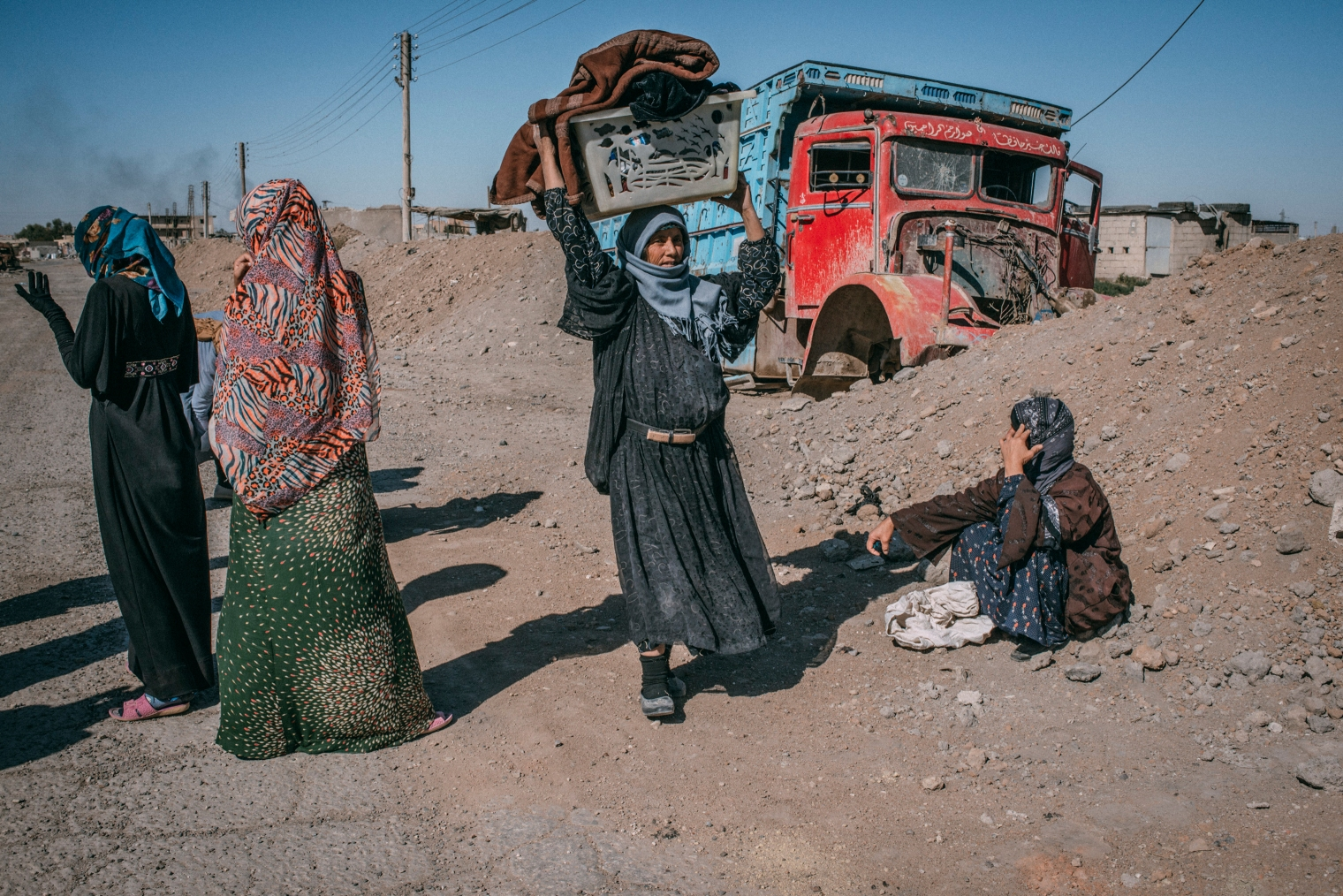 Civilians return to Raqqa to collect some of their belongings, which they left behind while fleeing the fighting between Syrian Democratic Forces and the Islamic State, on Oct. 18.