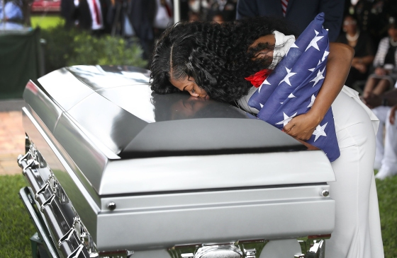 Myeshia Johnson kisses the casket of her husband killed in Niger