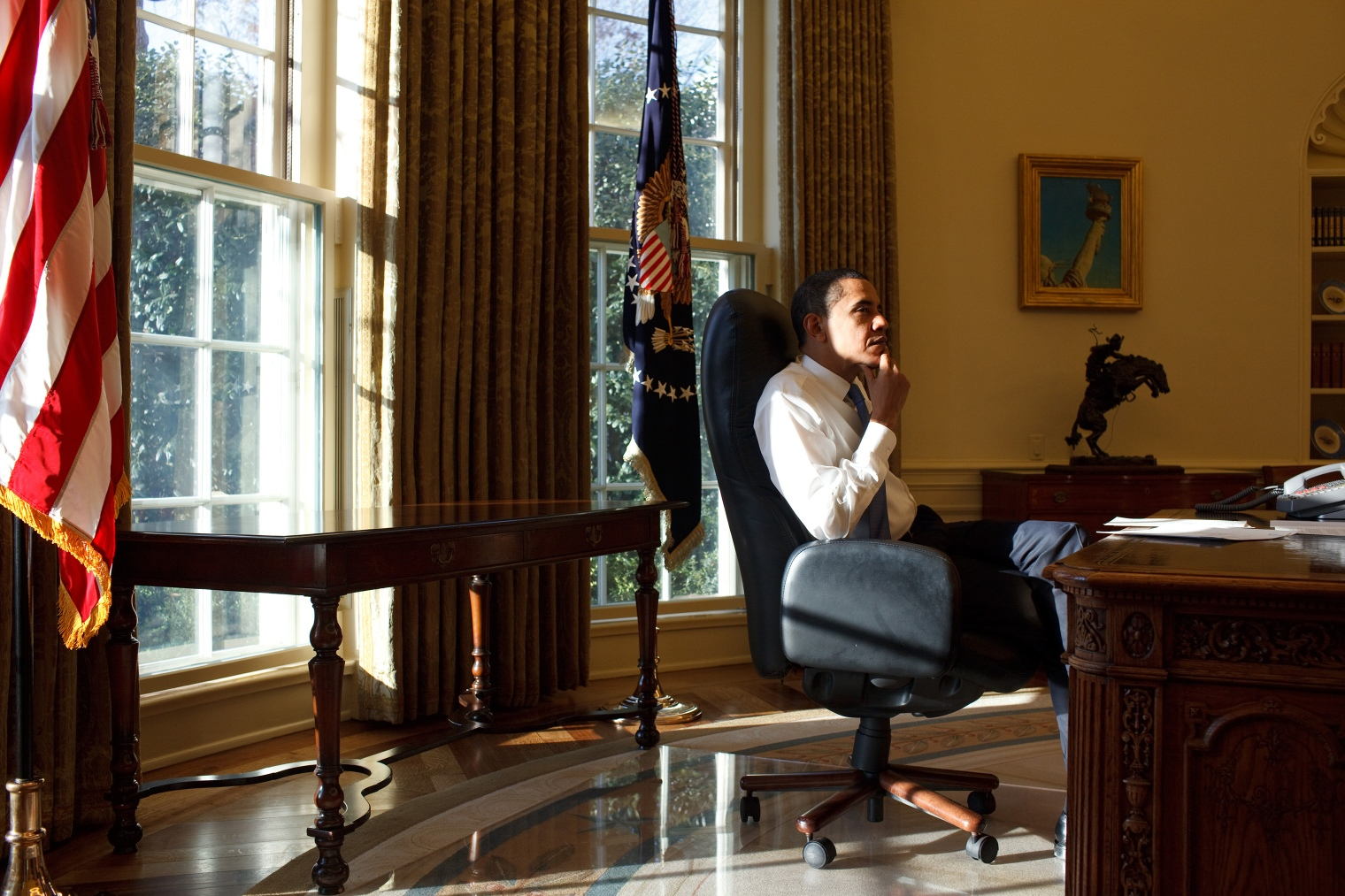 President Barack Obama in the Oval Office on his first day in office 1/21/09. Official White House Photo by Pete Souza