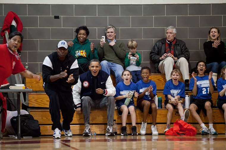 President Obama and then personal aide, Reggie Love, fill in coaching Sasha Obama's basketball team on Feb. 5, 2011.