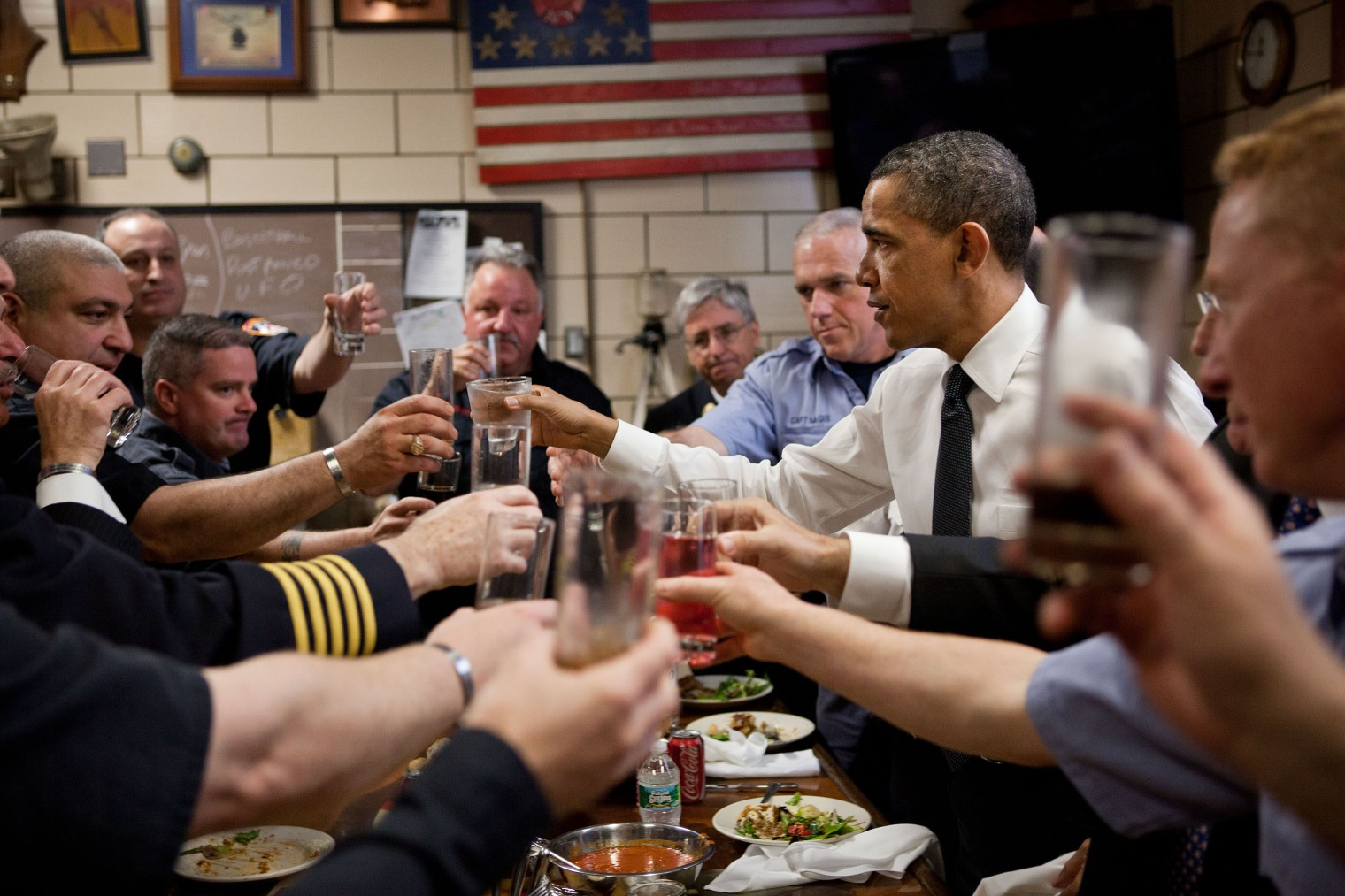 President Obama and firefighters toast during a lunch at Engine 54, Ladder 4, Battalion 9 Firehouse, that lost 15 firefighters on 9/11, in New York, on May 5, 2011.